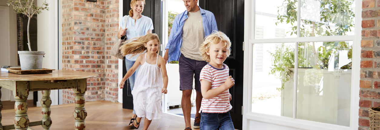 Young family arriving back to their home after their new heat pump installation.