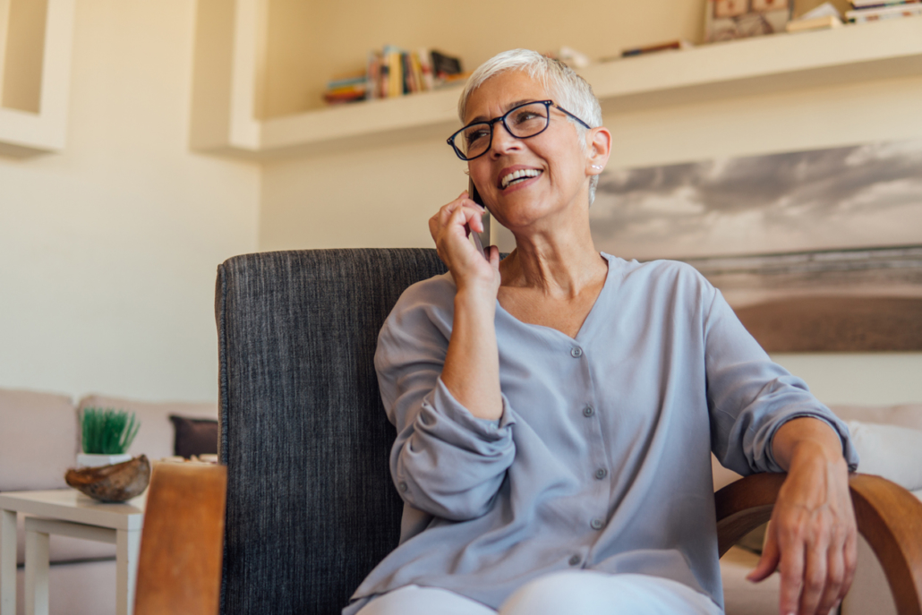 Senior woman calling for emergency HVAC repair in Katy, TX.